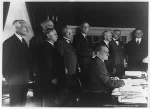President Calvin Coolidge signs the 1926 revenue act. Treasury Secretary Andrew Mellon is on the far left. Photo courtesy of the Library of Congress.